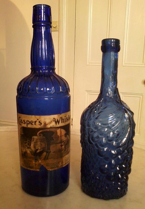 Caspers Whiskey next to a Figural Grape - Aprill Collection