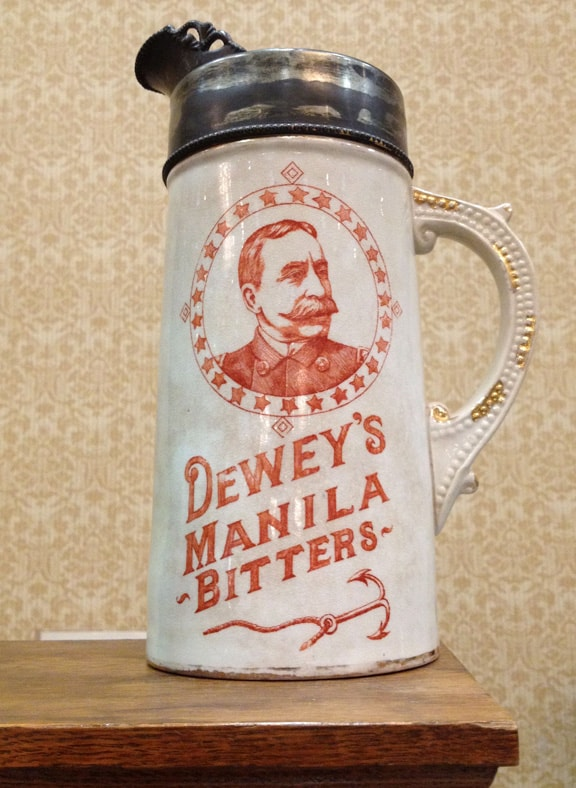 Legendary DEWEY's MANILLA BITTERS pitcher on Dan Cowman's table. The pictcher used to be in the collection of the Booths.