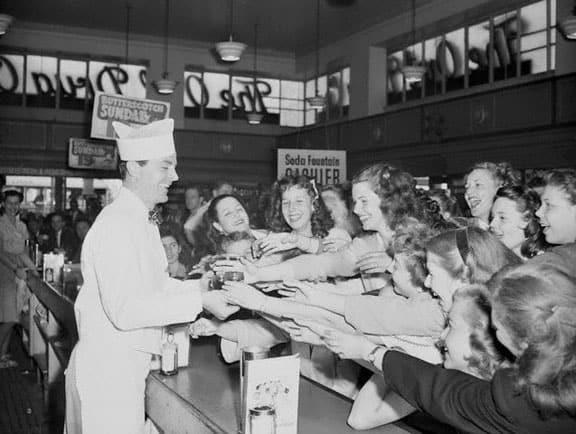 Actor Dana Andrews Serving Sodas to Fans