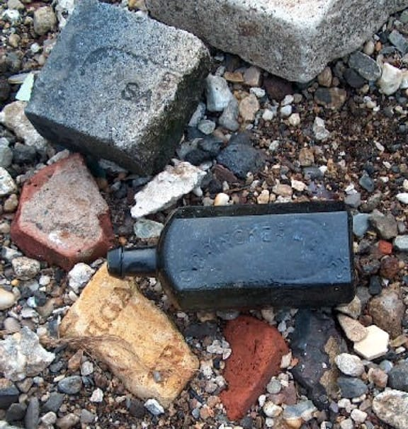 Scott Jordan dug the rare Brinckerhoff's bottle shown here in Jersey City, New Jersey. The crucible, fire brick, and cullet came from the same site. See page 2 for a full account of this unusual dig.